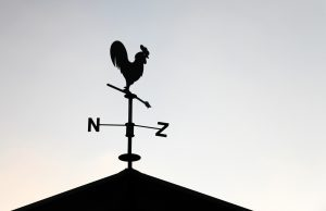 Black weathervane in the form of a rooster