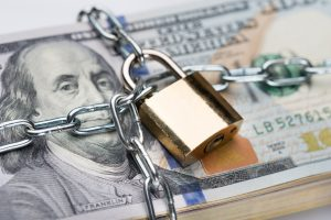 Chain And Padlock Around Dollar Bundle