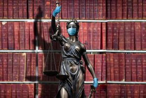 GettyImages-1251456135-covid-justice-e1600885125952-300x201