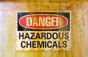 Danger Hazardous Chemicals Sign on a stained storage barrel